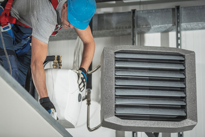 HVAC worker on the job